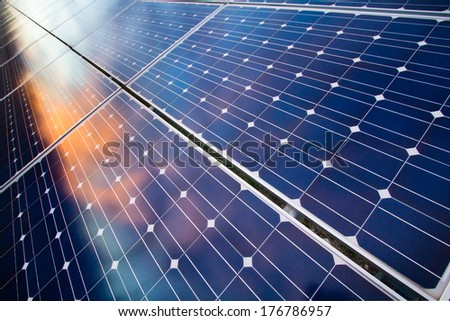 Reflexion of the clouds on the photovoltaic cells - stock photo