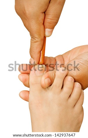 Reflexology foot massage, thai spa foot treatment by wood stick - stock photo