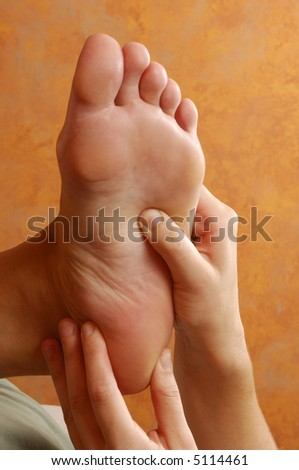 Reflexology Foot Massasge at Day Spa - stock photo