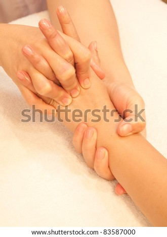 reflexology Hand massage, spa hand treatment,Thailand - stock photo