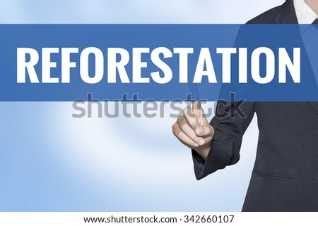 Reforestation word on virtual screen touch by business woman blue background - stock photo