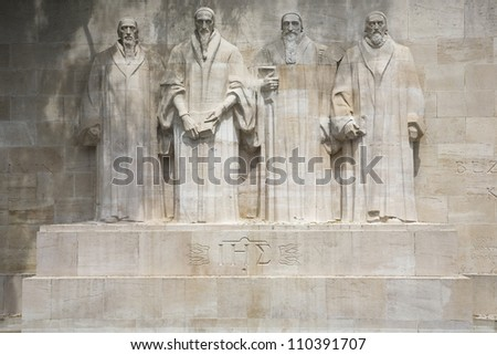 Reformation wall in Parc Des Bastions in Geneva, Switzerland.  Depicted are William Farel, John Calvin, Theodore de Beze and John Knox.  These statues are more than 15 feet high each. - stock photo