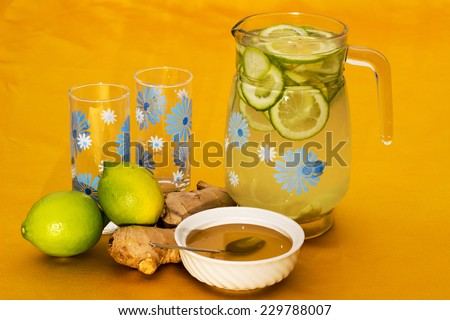Refreshing and healthful drink with lemon, ginger and honey. - stock photo