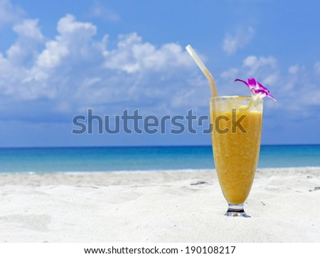 Refreshing cocktail on tropical beach - stock photo