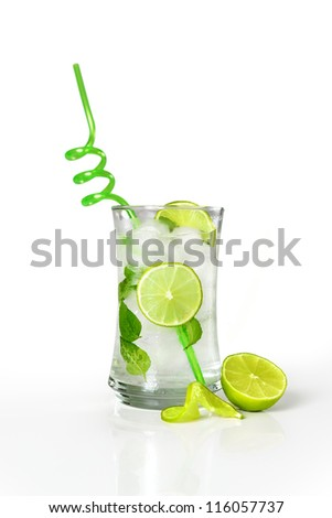 Refreshing cold mojito drink with fresh lime slices and ice - stock photo
