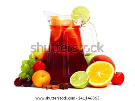 Refreshing fruit sangria in jug with different fruits isolated on white - stock photo