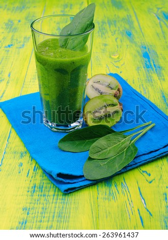 Refreshing green smoothie with kiwi and spinach. Diet shakes. Healthy Eating. Wooden board rustic - stock photo