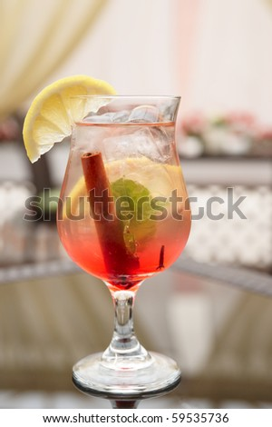 Refreshing iced cocktail on restaurant table - stock photo