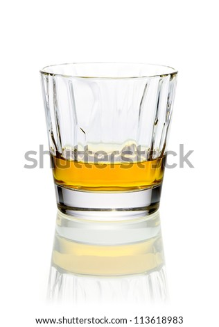 Refreshing relaxing glass of whiskey or brandy in a tumbler on a white background with reflection - stock photo