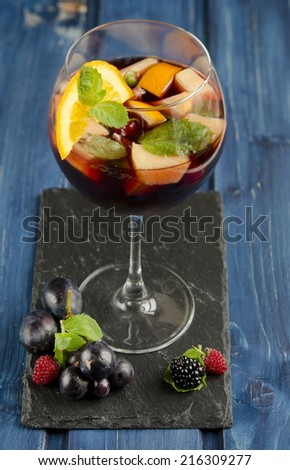 Refreshing sangria with fruits - stock photo