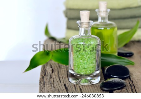Refreshing spa set with scented sea salt and infused herbal water for relaxing aroma therapy or stone massage - stock photo