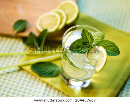 Refreshing summer cocktail with lime and mint - stock photo