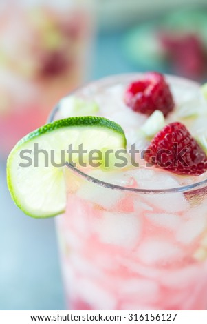 Refreshing Summer cocktail with raspberries and lime - stock photo