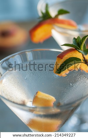 Refreshing Summer cocktails vodka martinis with fresh peaches - stock photo
