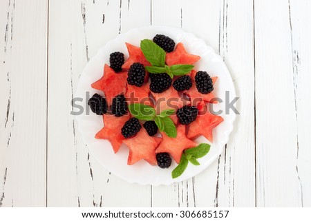 Refreshing watermelon salad with blackberries and mint. Fresh star shaped watermelon. Top view - stock photo