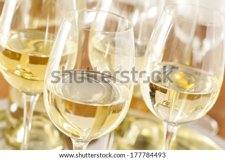 Refreshing White Wine in a Glass on a Background - stock photo