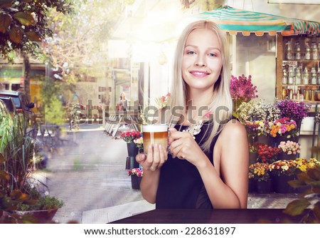 Refreshment. Happy Woman with Cup of Coffee in a Street Cafe - stock photo