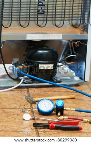 refrigerator appliance troubleshooting and maintenance works background - stock photo