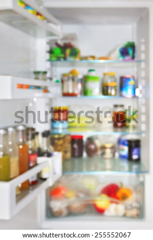 Refrigerator full of different food. Unrecognizable soft blurred - stock photo
