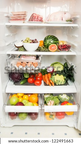 Refrigerator Full of Fresh Fruits, Vegetables, and Organic Meats - stock photo
