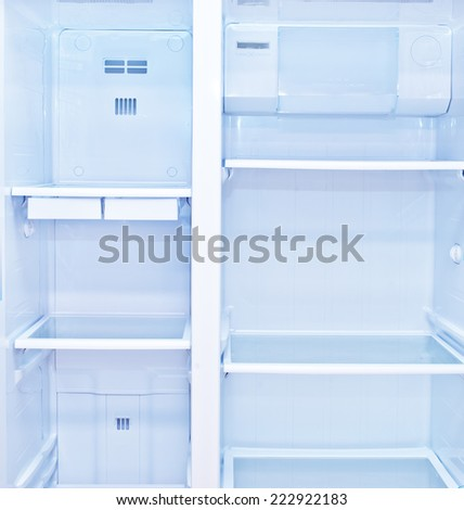 refrigerator with open doors - stock photo