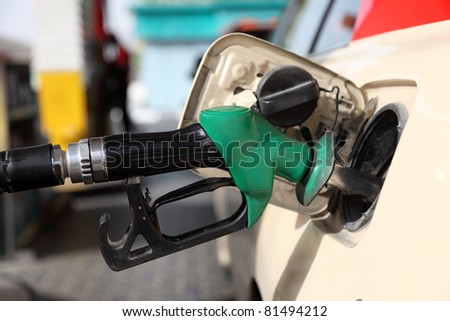 Refueling a car at gas station - stock photo