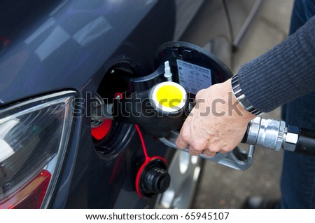 refuelling at the gasstation - stock photo