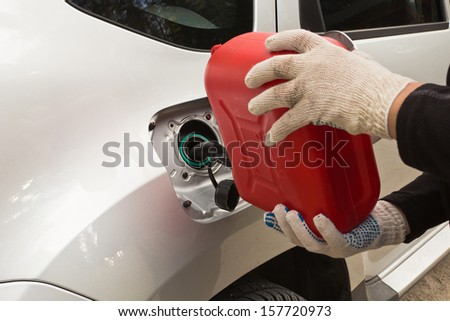 refuelling of petrol by canisters - stock photo