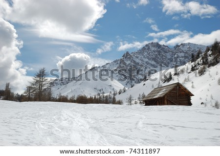 Refuge in the Alps near Briancon, Wooden huts in the snow, France - stock photo