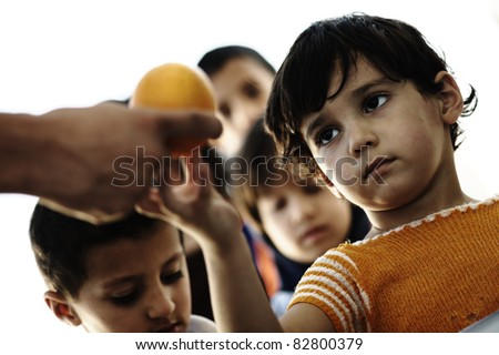 Refugee camp, poverty, hungry children receiving humanitarian food - stock photo