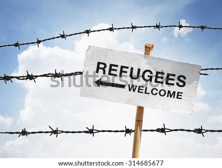 refugees welcome sign and barbwire background - stock photo