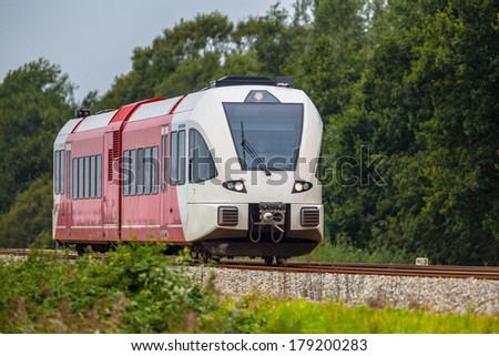 Regional Light Train on its Jouney in the North of the Netherlands - stock photo