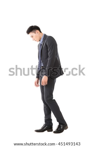 Regret young business man standing and thinking, full length portrait isolated - stock photo