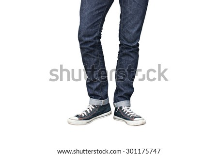 Regular Fit Straight Leg Jeans and Retro Canvas High Top Sneakers isolated on white background, selective focus (detailed close-up shot) - stock photo