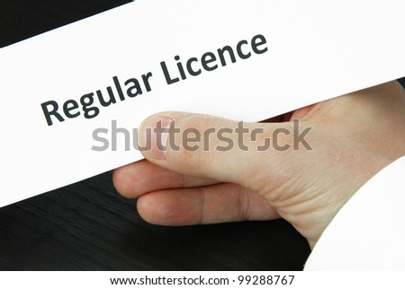 Regular licence sign with hand - stock photo