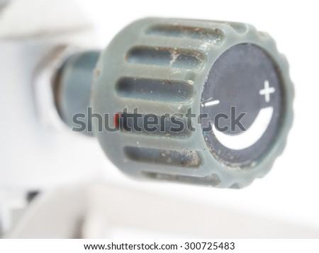 regulating handle plus or minus on a white background - stock photo