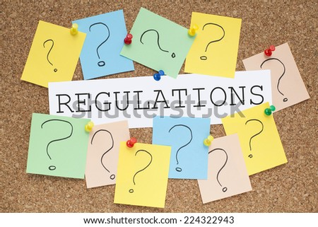 Regulations Concept on Cork Board - stock photo