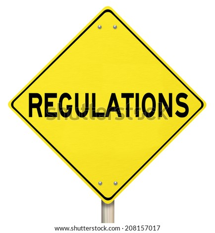 Regulations word on a yellow warning or danger road sign illustrating the perils of not following rules, laws and guidelines - stock photo