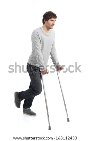 Rehabilitation of an adult man walking with crutches isolated on a white background               - stock photo