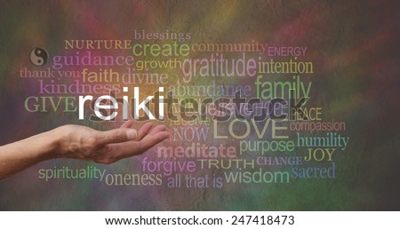Reiki in the palm of your hand     Female hand outstretched with the word REIKI floating above, surrounded by healing related words on a wide multicolored stone effect background - stock photo