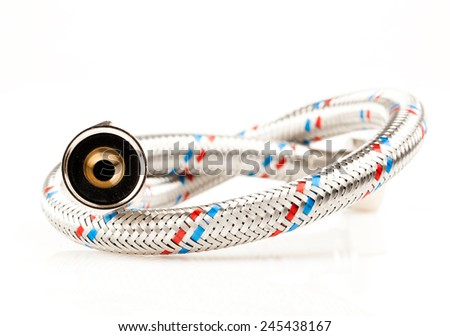 Reinforced water hose on white background. - stock photo