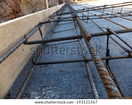 reinforcement mesh and rods of table prepared for concrete - stock photo