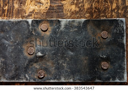 Reinforcement. Old Iron reinforcement on a old wooden crate. - stock photo