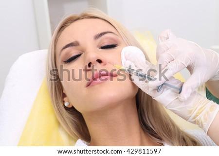 Rejuvenating facial injections. - stock photo