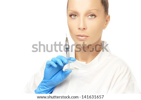 Rejuvenation.Attractive doctor prepare to Injection of beauty products.Looking at camera - stock photo