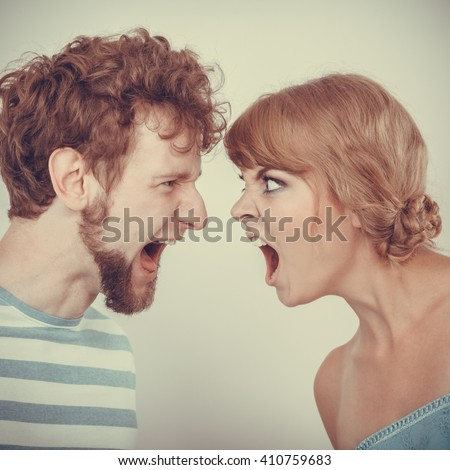 relationship difficulties. Angry woman and man yelling at each other. Face to face. - stock photo