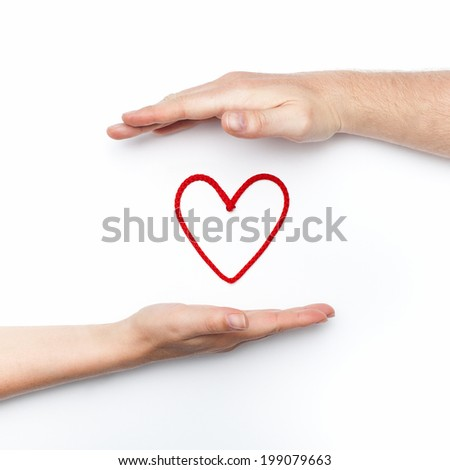 relationship photo with two hands with red heart holding and protecting in their palms - stock photo