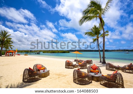 Relax area on tropical sandy beach in Mauritius Island - stock photo