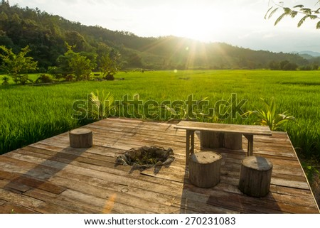 Relax corner in Green rice fields at evening - stock photo
