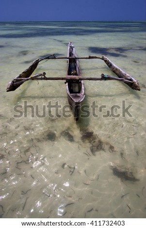 relax  of zanzibar  africa coastline boat pirague in the  blue lagoon  - stock photo